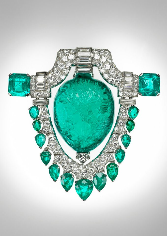 Marjorie  Merriweather Post's platinum brooch from the 1920s, featuring a  spectacular 60-ct. carved Mughal emerald surrounded by diamonds.