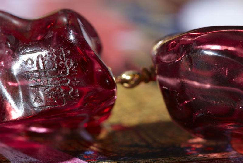 Detail:  Inscription on an Imperial Mughal spinel necklace. These spinels mainly  originated from the Badakhshan mine, in the 'Pamir' region (on the  frontier between Afghanistan and Tajikistan). This province gave its  derived name to spinels, described as 'Balas rubies' for decades.