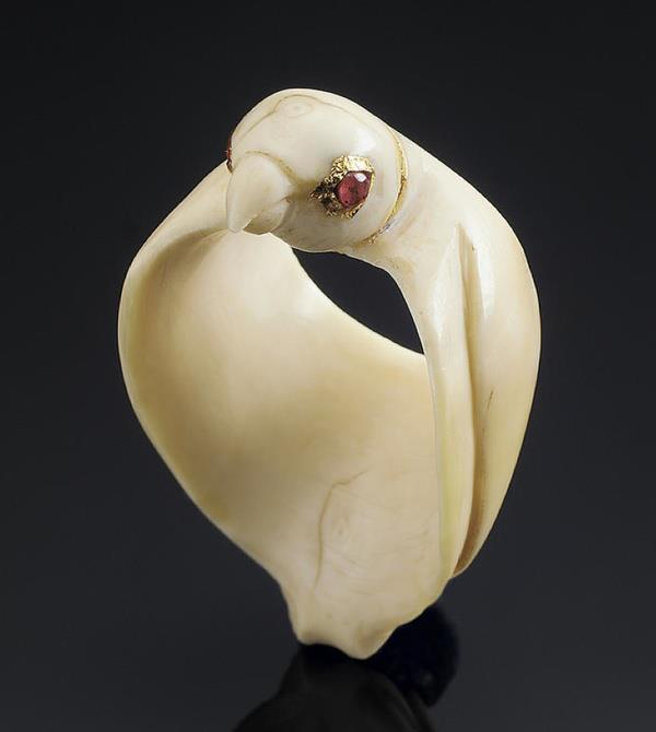 An  unusual ivory Archer's Ring in the form of a Falcon probably Mughal,  18th Century formed by a three dimensional bird with ruby-set eyes and  folded wings. Photo: Bonhams.