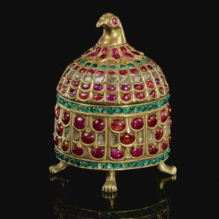An Indian gem-set gilt-metal casket with bird-head finial. Mughal, India. Photo: Sotheby's