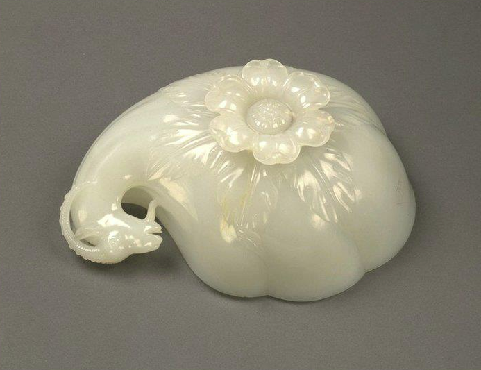 Mughal ruler Shah Jahan's Wine Cup. Jade. 1657.       Jade cup carved in the form of a shell or gourd with carved handle  terminating in the head of an Ibex & large floret shaped foot, left  side underside view. This large cup is the finest known example of  Mughal jade-carving. The Emperor's titles are carved on its side along  with the date. Source: V&A Museum