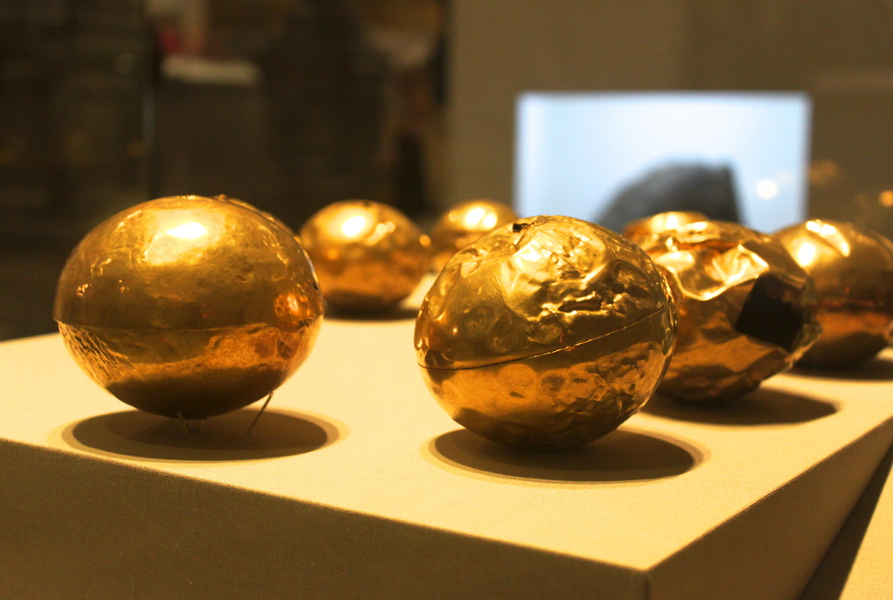 Hollow gold balls. Late Bronze Age, Ireland. Graduated sizes and with holes suggest that these balls could have been strung together to form a necklace.