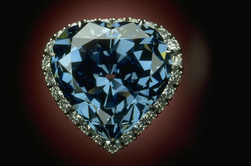 The Blue Heart Diamond photo shown here set in a platinum ring surrounded by 25 white diamonds. The stone measures 20.01 mm wide, 19.99 mm tall and 11.89 mm deep. Photo by Chip Clark, Smithsonian National Museum of Natural History.