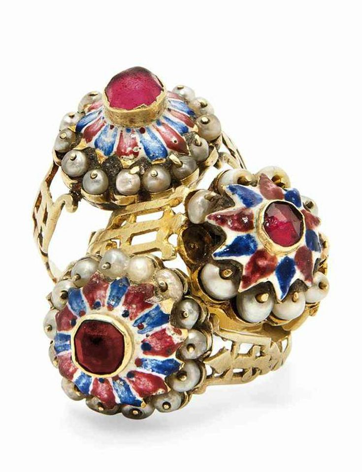 Three Qajar Enamelled Gold Rings, 19th century. Image: Christies