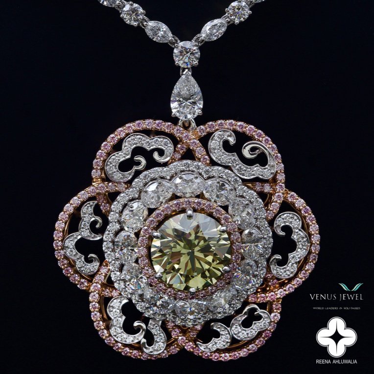 The ' Imperial Diamond Necklace ' is designed by award-winning designer Reena Ahluwalia and commissioned by Venus Jewel - World Leaders in Solitaires. Materials: 8.60 ct., Canadian greenish-yellow diamond from Ekati Mine, purplish-pink Argyle Pink Diamonds and white diamonds set in 18k white and rose gold.