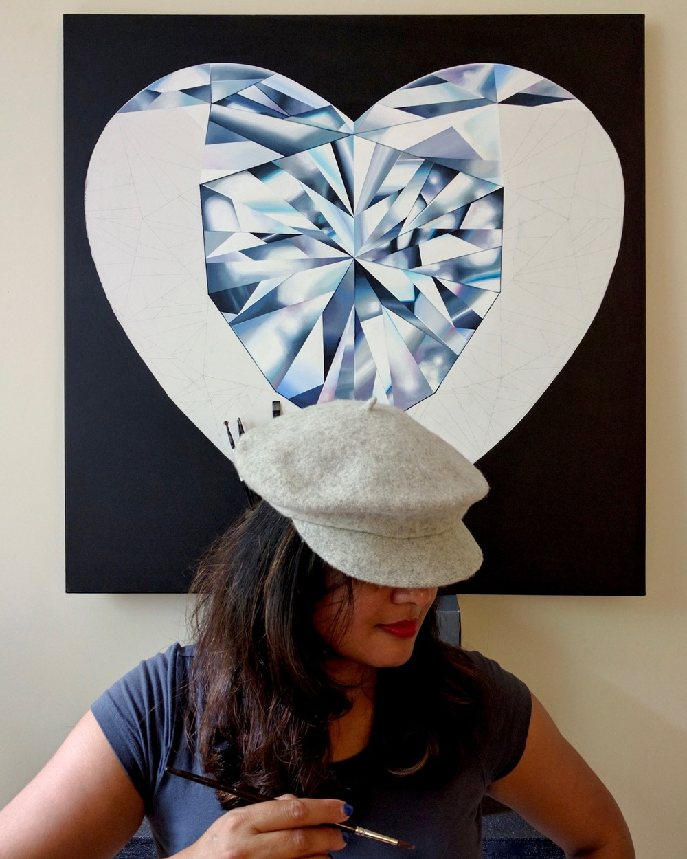 When your heart is in the right place. 'Pure Heart' white heart-shaped diamond painting in progress. Reena Ahluwalia in her studio. ©Reena Ahluwalia