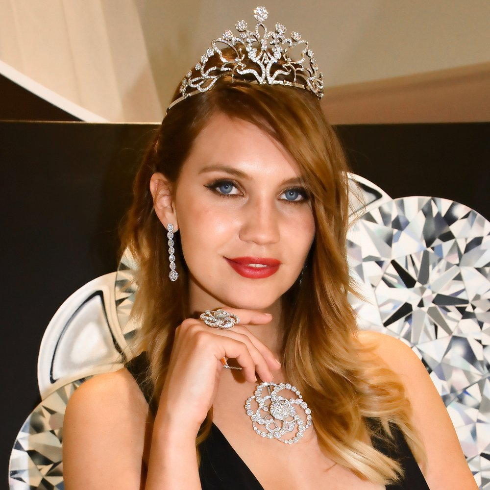 Miss Switzerland, Kerstin Cook radiates in the 'Inner Brilliance' spinning diamonds jewelry from 'Coronet By Reena Ahluwalia'. Image credit: Abdou HILALI | Baselworld