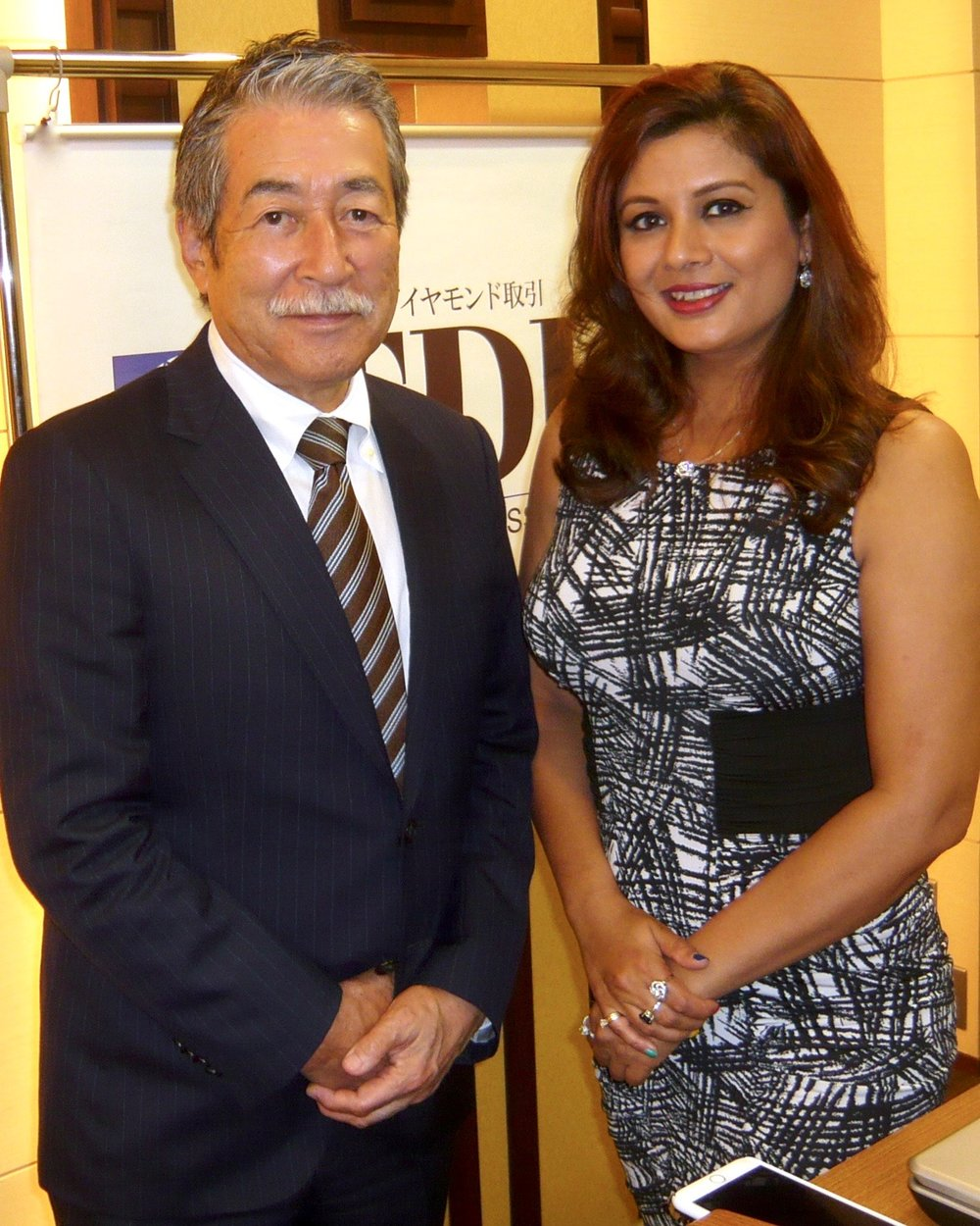 President of the Tokyo Diamond Exchange, Michio Iwasaki with jewelry designer, painter and professor, Reena Ahluwalia.