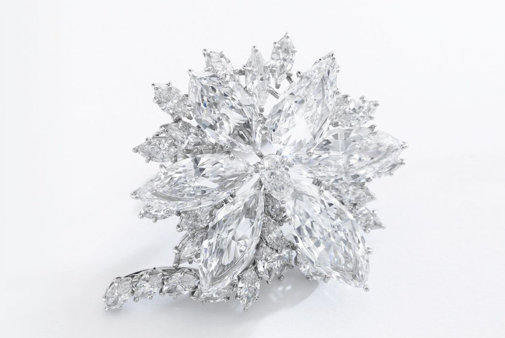 'The Star of Sierra Leone Diamond Brooch', Harry Winston. Of floral motif, set with a pear-shaped diamond, surrounded with a similarly shaped stone weighing 3.25 carats, and five marquise-shaped diamonds weighing 2.86, 2.97, 3.74, 3.93 and 4.30 carats, further highlighted with marquise-shaped stones, unsigned, maker's mark for Jacques Timey. Image: Sotheby's