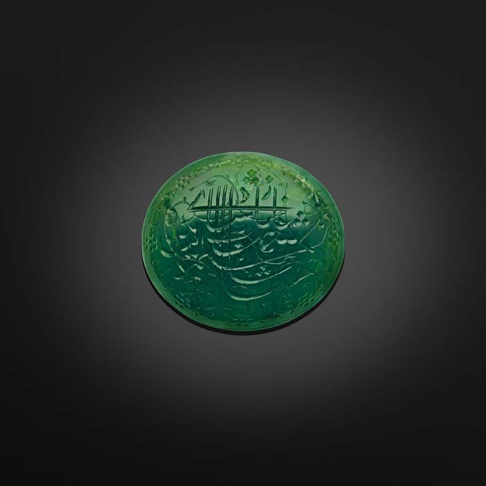 """The Shah Jahan Emerald.    North India or Deccan, dated AH 1031 (1621–22) Inscribed in Persian: Shihab al-din Muhammad Shah Jahan Padshah Ghazi 1031 (""""Shihab al-din Muhammad Shah Jahan Ghazi Emperor 1031"""").  Usually adorned with pious formulas, Koranic verses or mystical sayings, emeralds – unlike spinels or balas rubies often inscribed with royal titles – were rarely engraved with the names of the sovereigns who owned them, hence the singularity of this cabochon-cut emerald bearing the name of Shah Jahan.  Image courtesy: Al Thani Collection"""