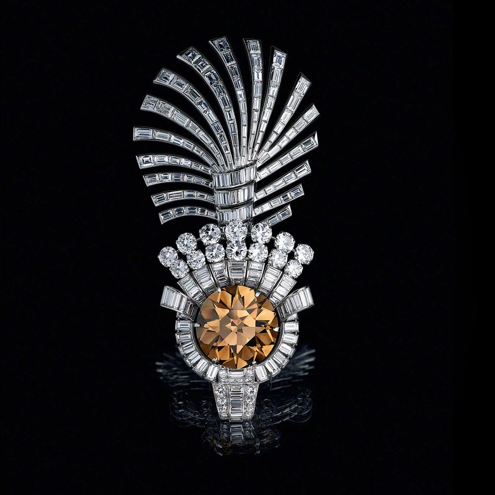 The 61.05 carat Tiger Eye Diamond in the Tiger Eye Turban Ornament. Cartier London, 1937  Platinum, diamond . Although the Cartiers were never technically diamond merchants, the deals they made and the work they did with some of the finest stones in the world played a key role in developing the firm's international stature. In 1937, Maharaja Digvijaysinhji of Nawanagar asked Cartier to set the 'Tiger Eye', an unusual cognac-coloured diamond discovered in 1913 and sold by the firm to his predecessor Maharaja Ranjisinhji. Cartier designed a turban ornament around the gem, using baguette-cut diamonds to create an Art Deco look for this traditional Indian jewellery form. Image courtesy: Al Thani Collection