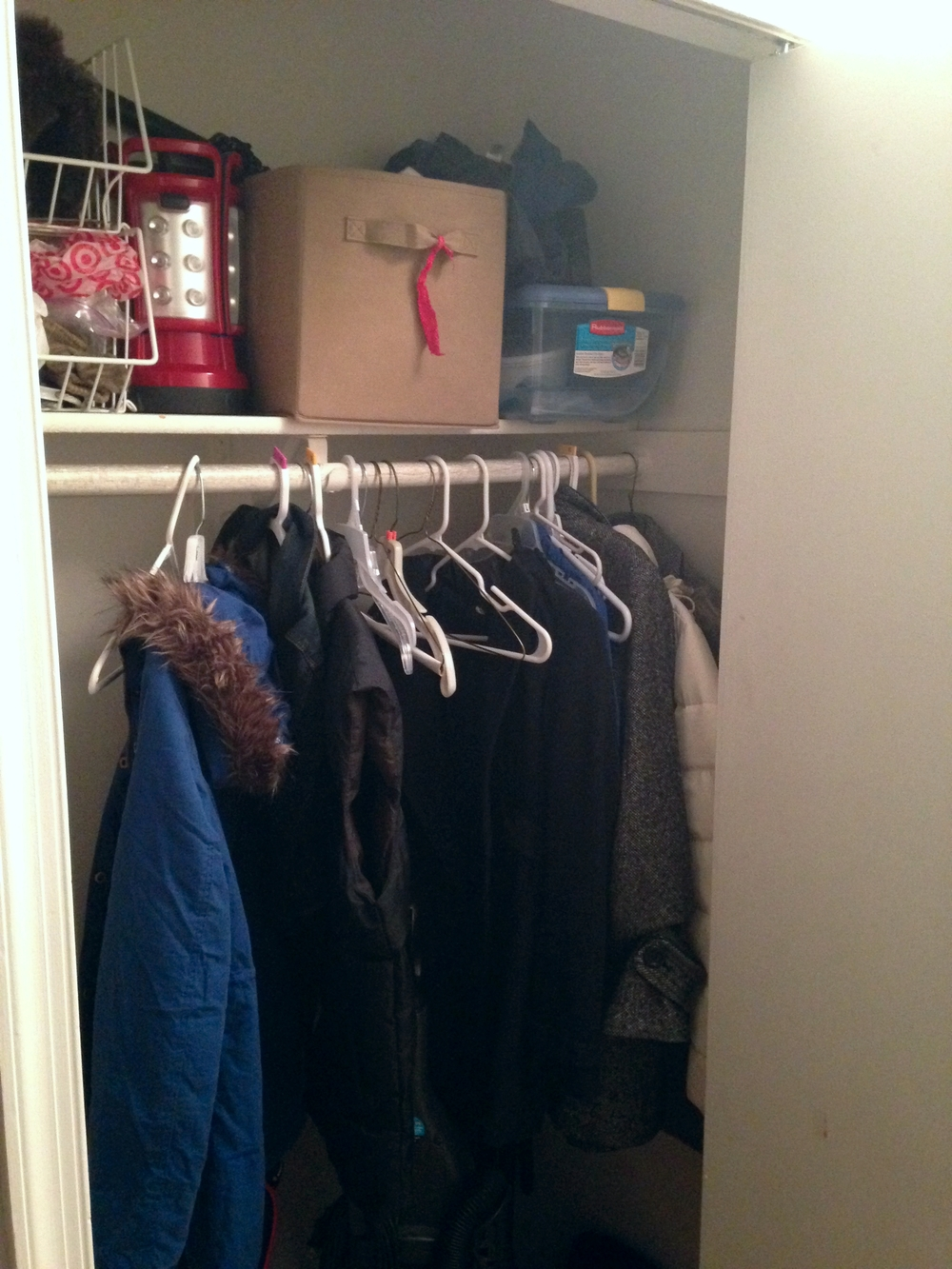 And here's the hall coat & vacuum closet. Right now our shoe storage is all over the place, and I want to do something about that...