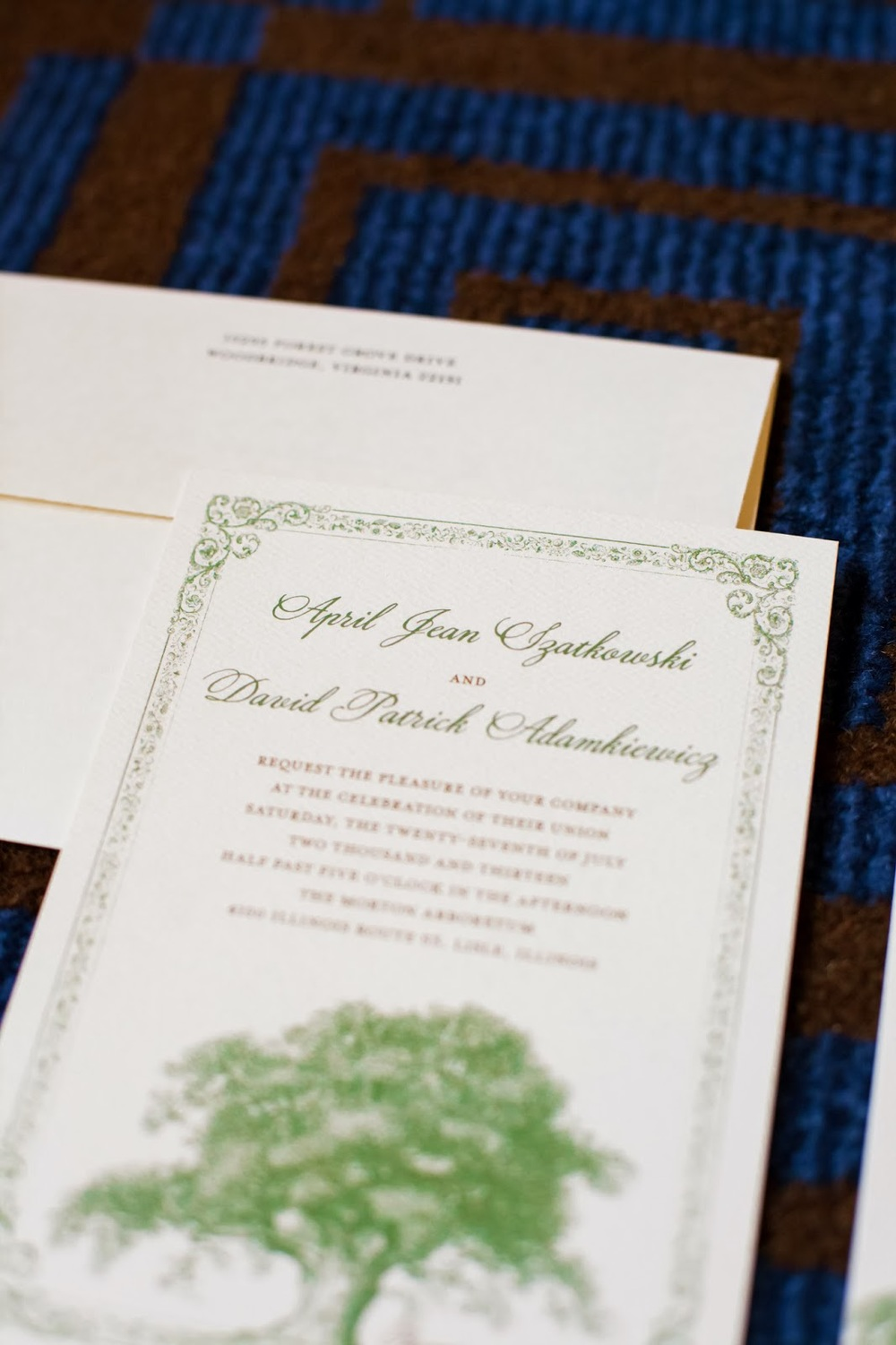 Ecru wedding invitation with oak tree design.