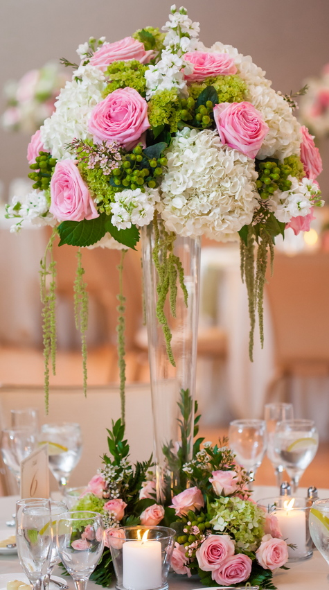 Hydrangea and rose centerpieces with candles.