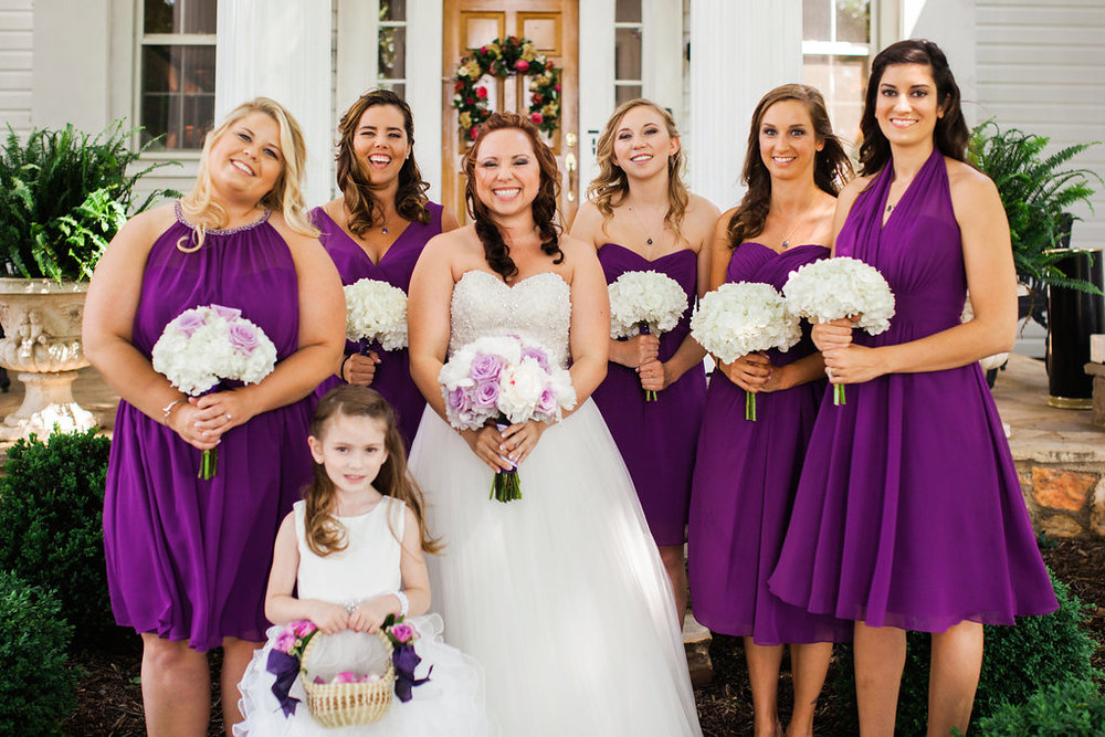 Bridal gown, bridesmaids, and flower girl dresses all purchased at Ellie's Bridal!