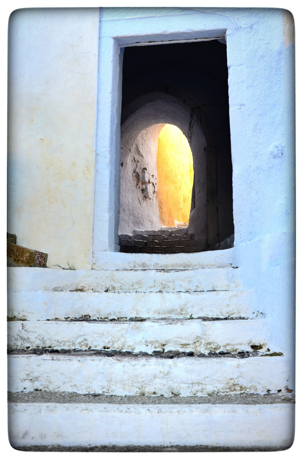 Steps and tunnel to one of the many churches in Pyrgos.