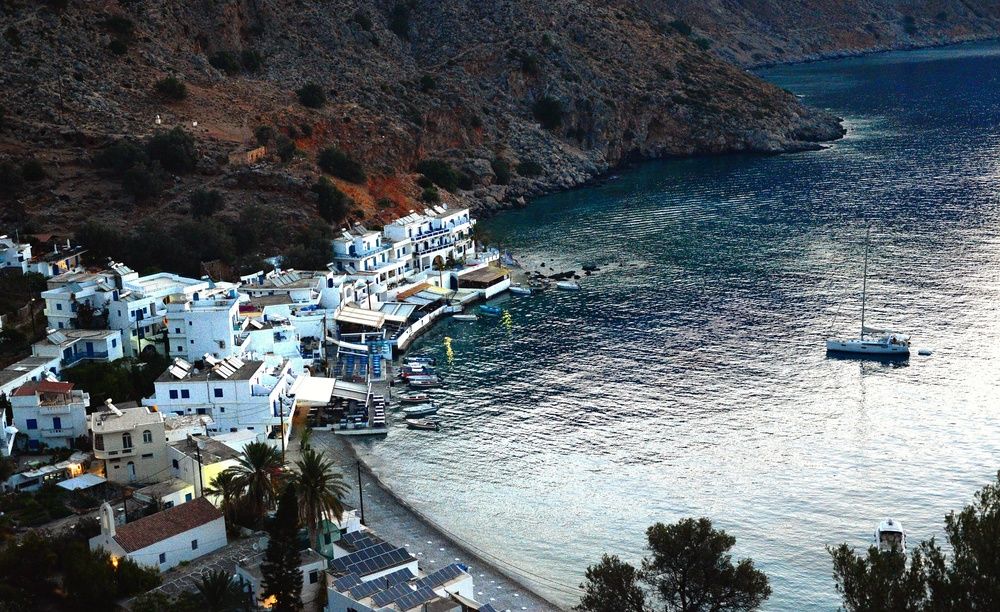 The sun is still behind the mountains, but Loutro looks lovely.