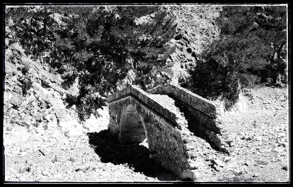 A bridge that was build went the riverbed was not so wide.