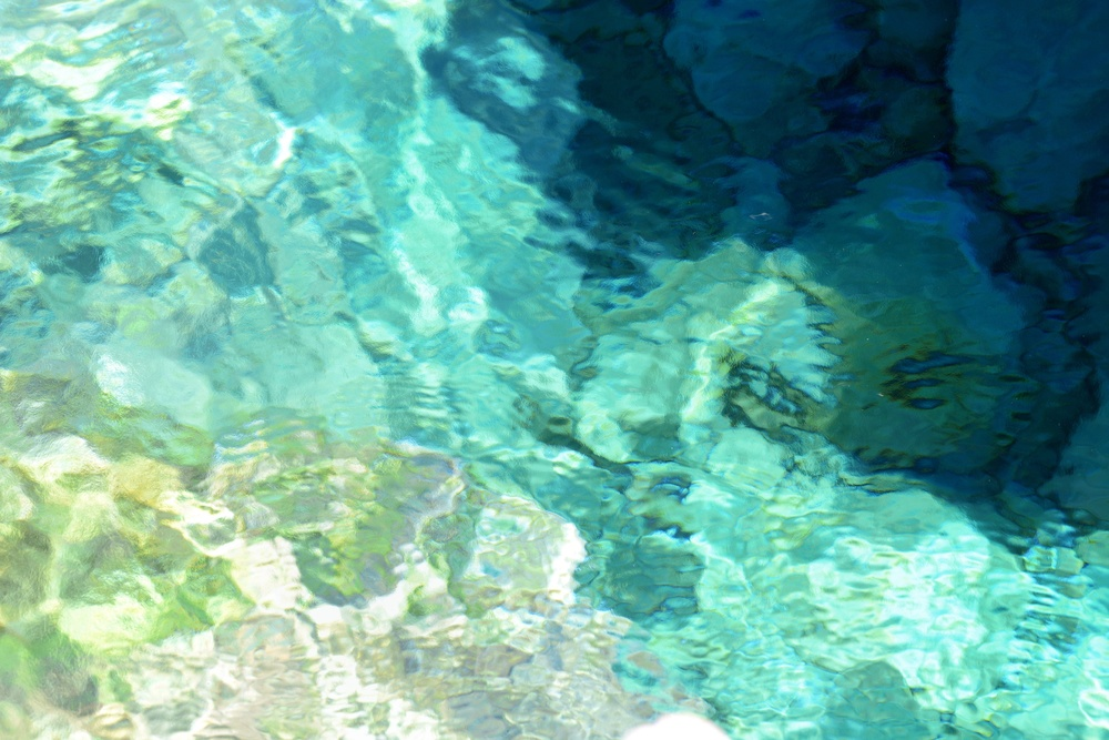 "In Loutro the sweet water is pushed to the surface like on the Glyka Nera beach. But it happens under water and you can see the ""smear"" of two liquids of different density mix."