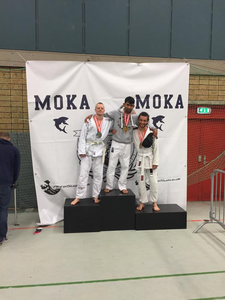 Suk and Valentin on the podium after their fights in the Adult White Belt Featherweight division.