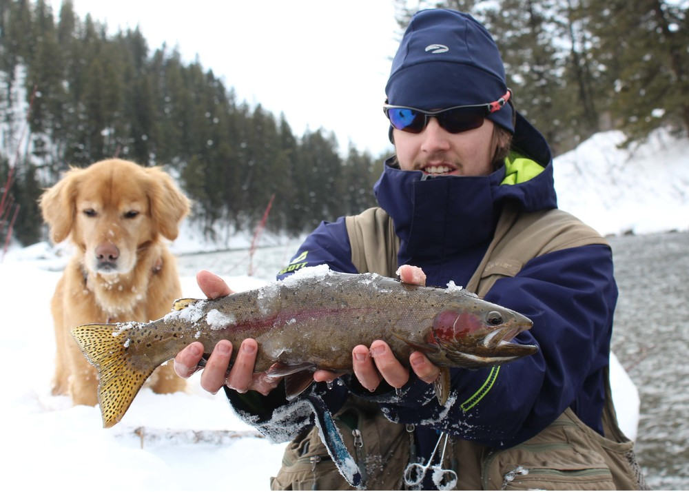 Henry the dog and East Slope guide Spencer Crider striking a pose with a beautiful Rainbow from 1/14/2014.