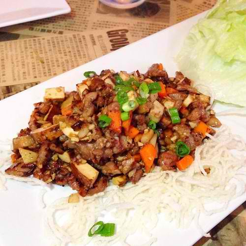 Crisp lettuce cups filled with stir fried mushrooms, water chestnuts, carrots, bean curd, garlic, ginger and your choice of protein