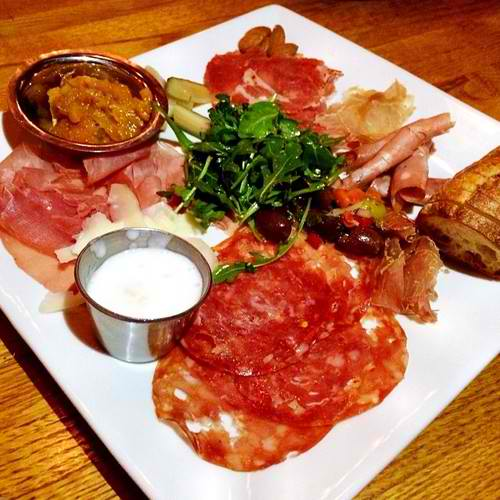 Salumi Platter. dry cured meat platter served with chef compote, pickled veggies, evoo cured olives, pig butter & a fresh tuscan loaf