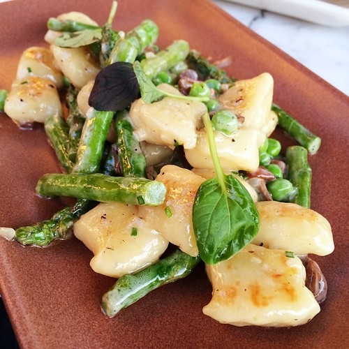 Caramelized gnocchi with snow peas & asparagus in a Parmigiano Reggiano cream