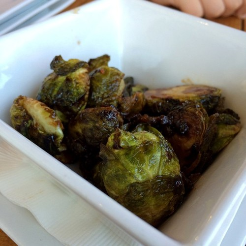 Lightly fried Brussels sprouts and candied bacon drizzled with balsamic vinegar