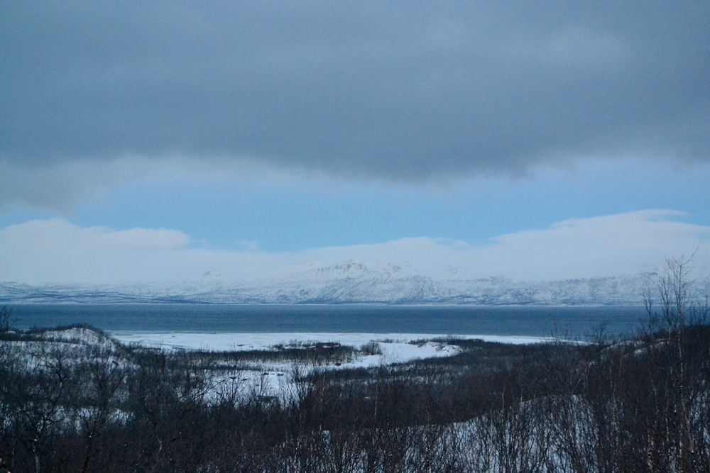 A view of Lake Torenträsk and the mountains that line it.