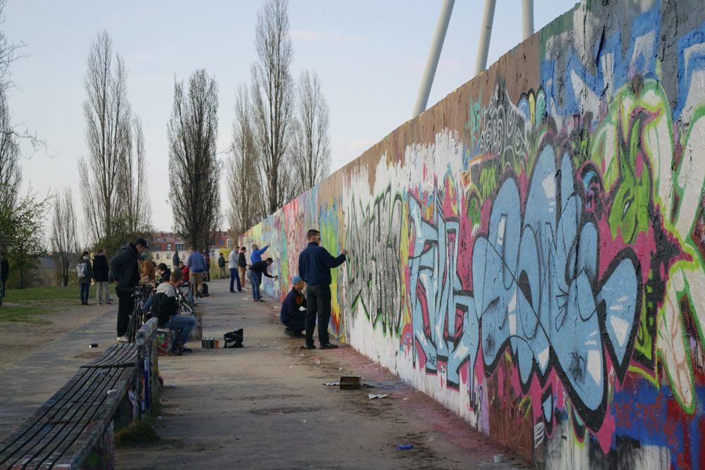 Graffiti artsits at work at the Mauerpark.