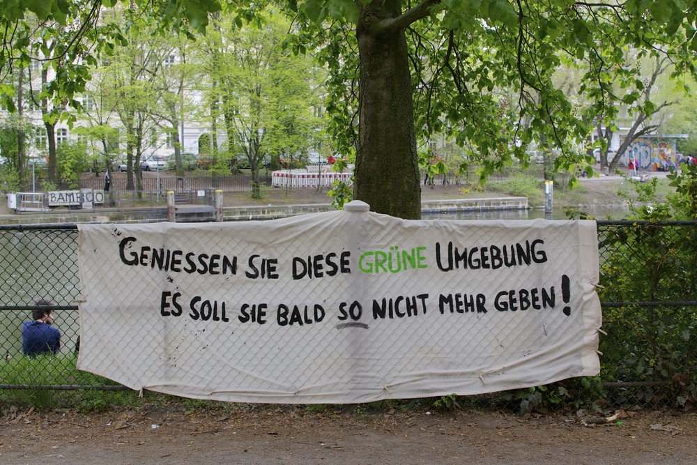"""Enjoy these green surroundings. Soon they won't be like this anymore!"" (seen in Kreuzberg)"