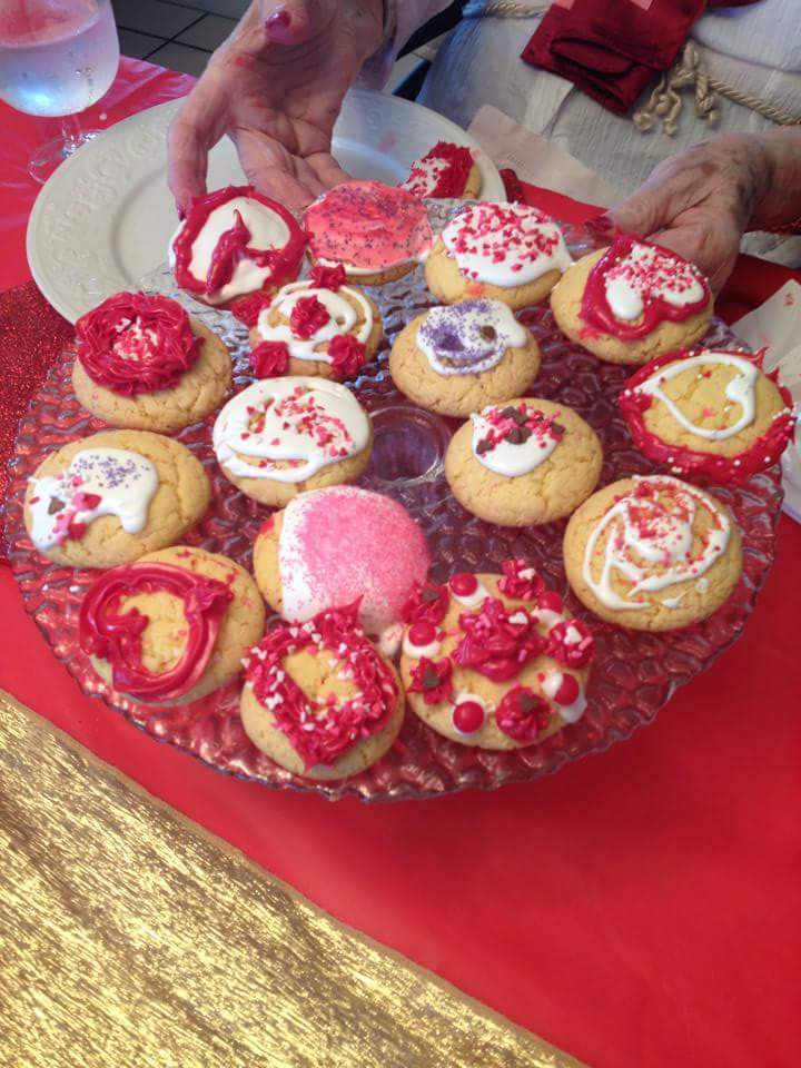 Residents made and decorated these cookies for the party.  Gladys is showing off the plate she decorated.