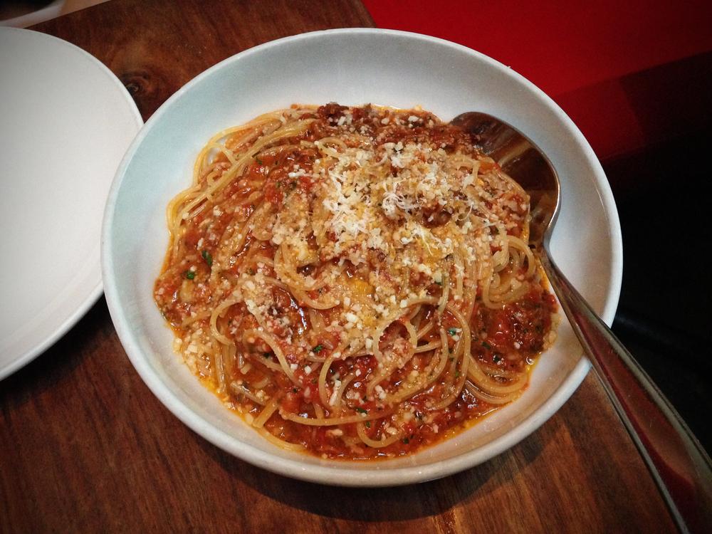 Tomasso's sumo calabrese: spaghettini, tomato braised pork and rib sugo, pecorino romano