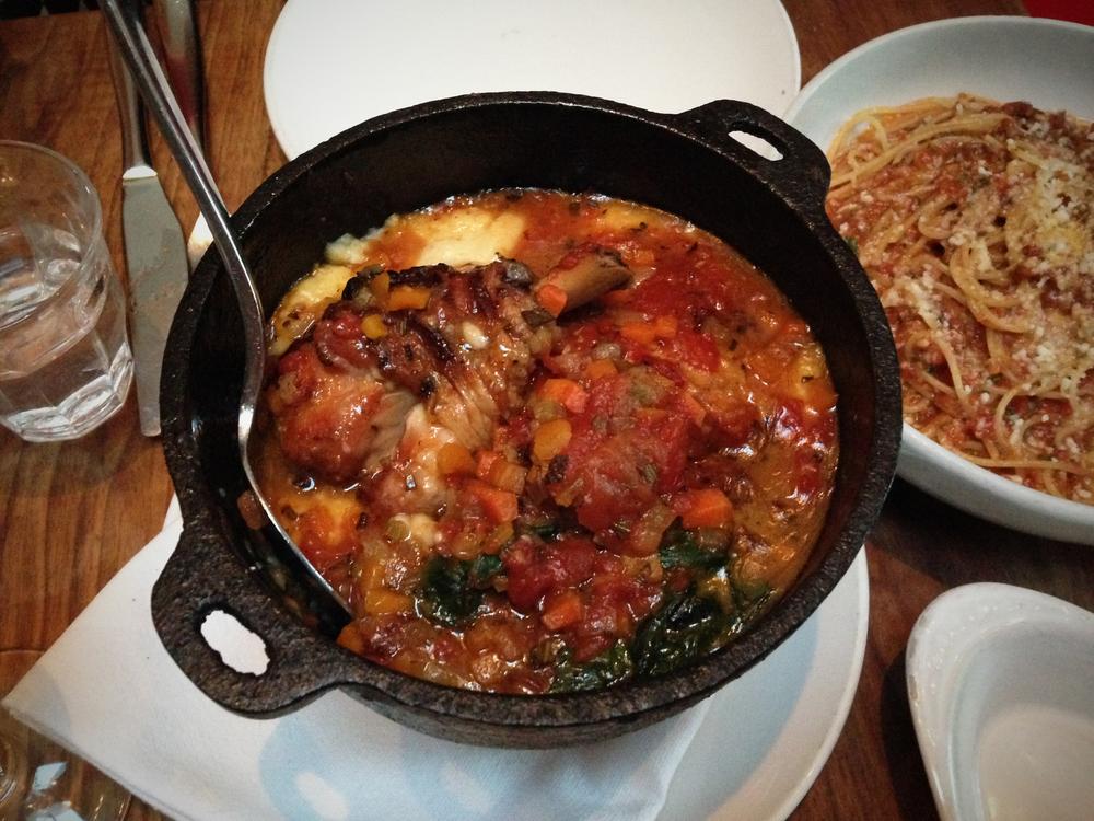 Nonna's tomato braised chicken, sautéed greens, polenta