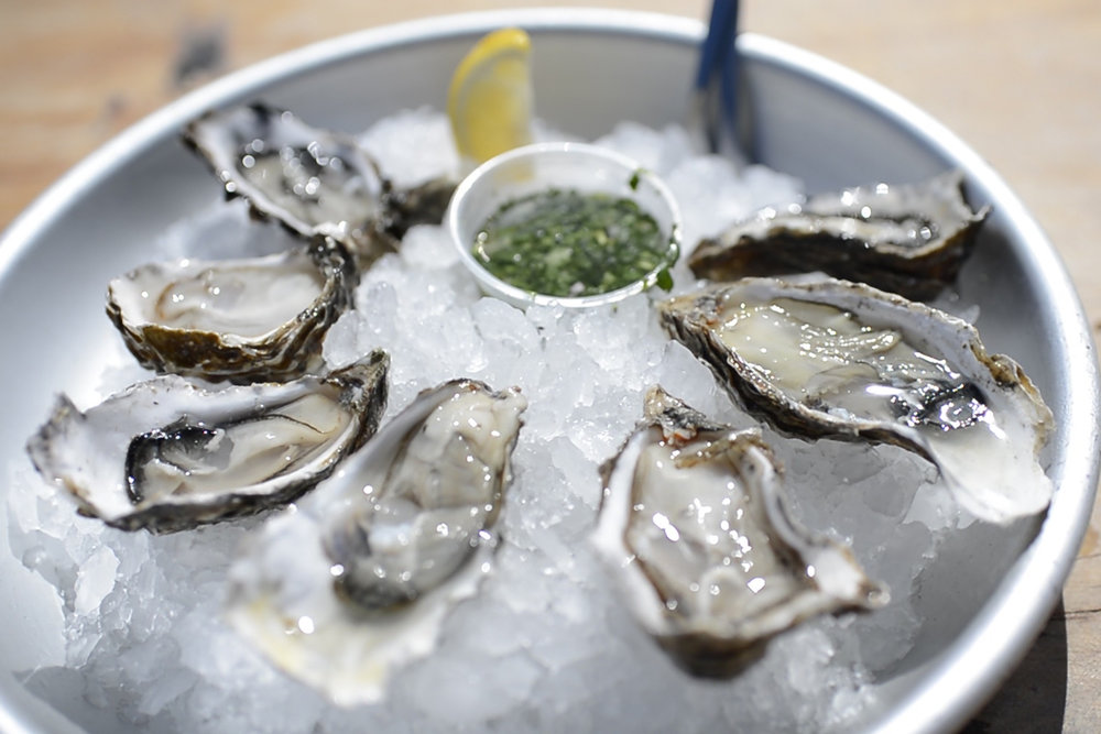 Shucking and slurping California-grown oysters right out of their salty bay waters. #tomalesbay #oysters