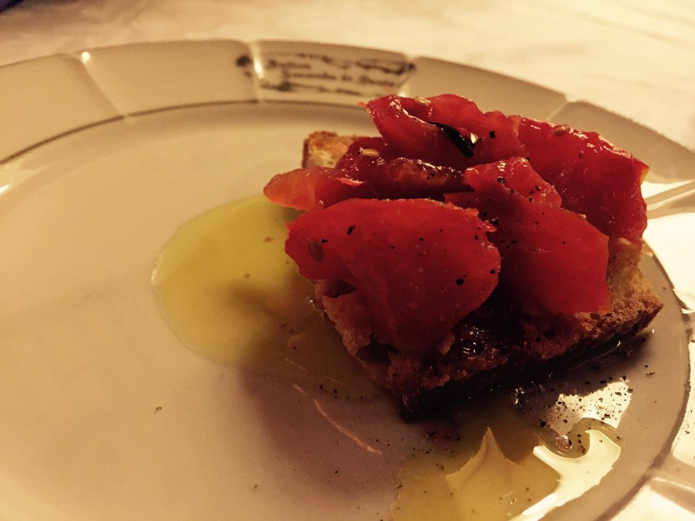 Crusty old bread, summer tomato from the orto and olio from the grove of Aurelio Barattini in Lucca.