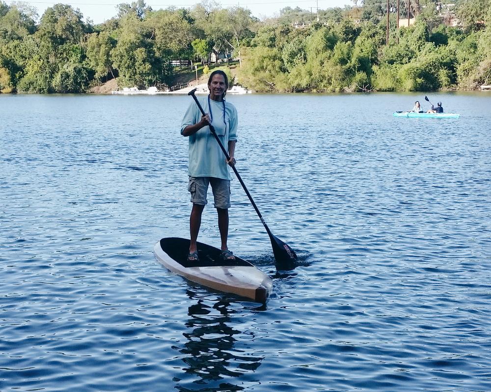 Lisa paddle boarding lady bird lake
