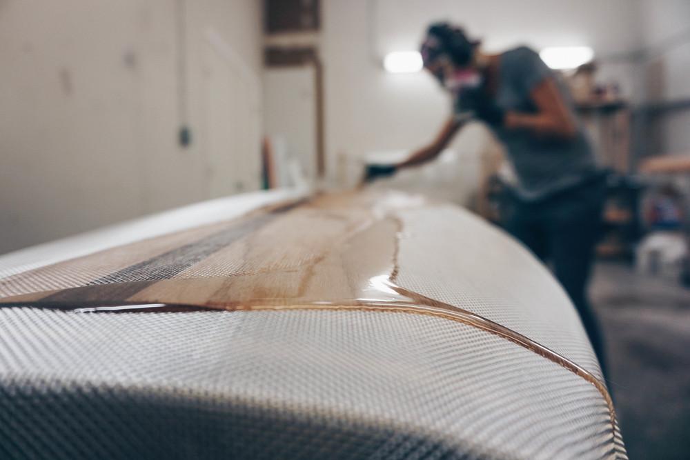 Fiberglassing custom wood sup.jpg