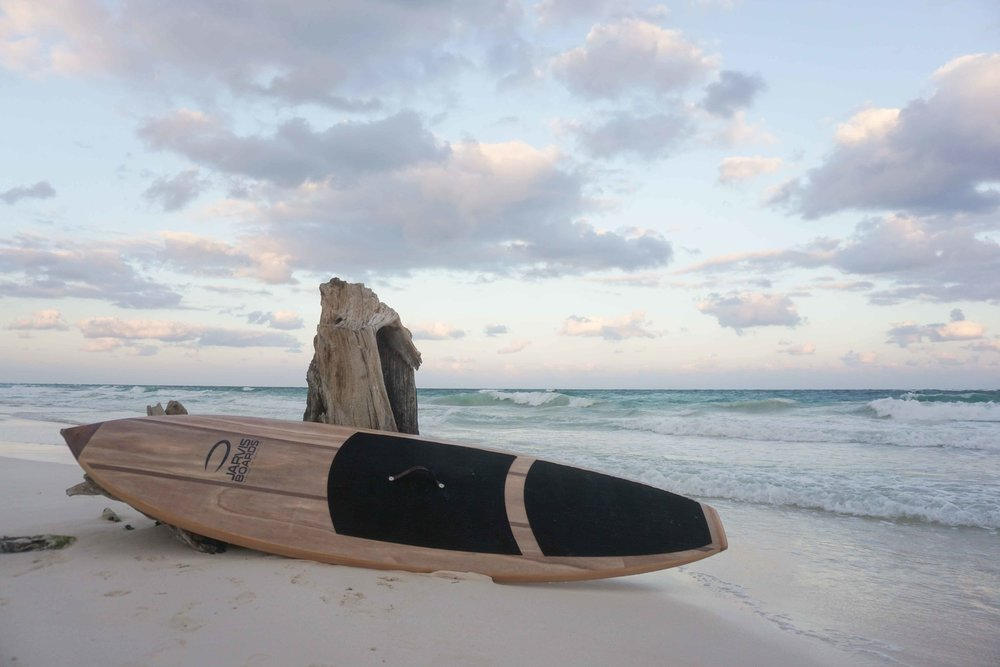 Wooden Paddle board ready for action on the beaches of Tulum, Mexico!
