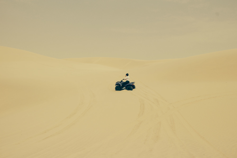 I was lucky to get to go to Doha for work. On a half day off we went to ride quad bikes in the desert, most of the time my camera was fogged up because of the heat and humidity, but I managed to get this shot of Bo on her way up a sand dune.