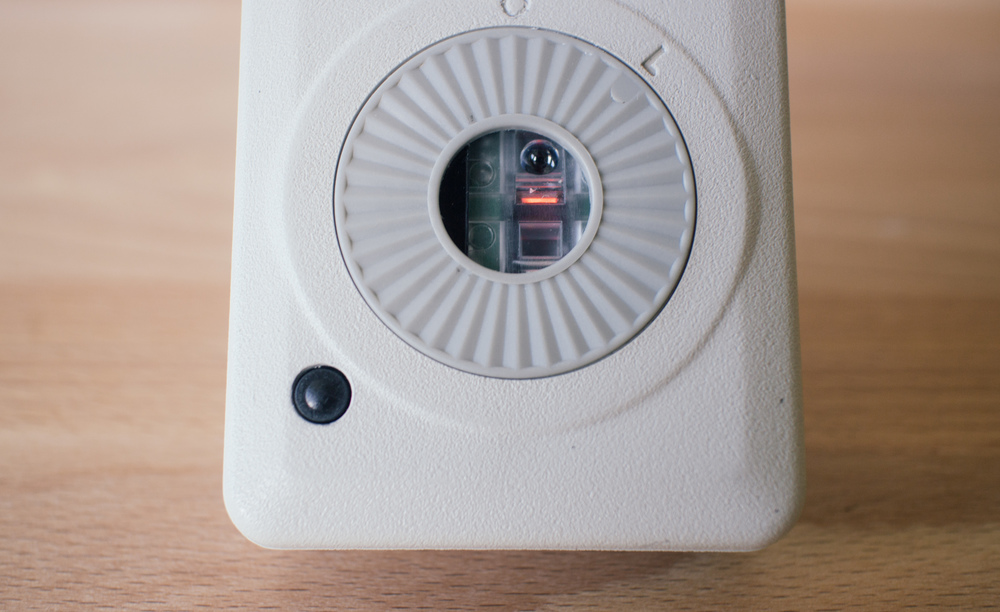 The optical sensor assembly is aligned with the hole in the ball cover. The black button on the bottom left is the power switch.