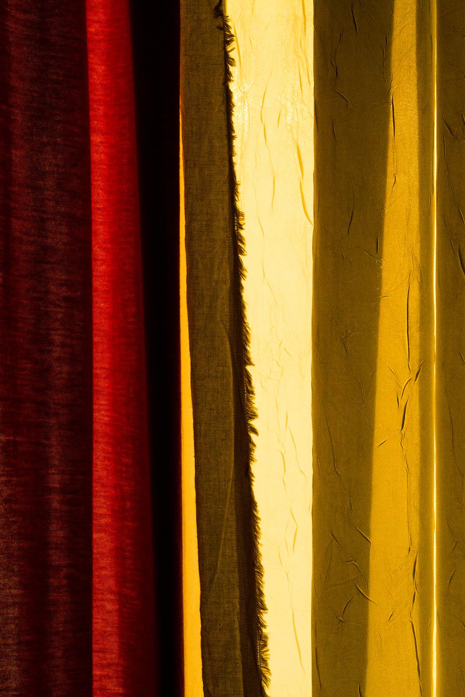 red curtain-dawn-window-yellow-light