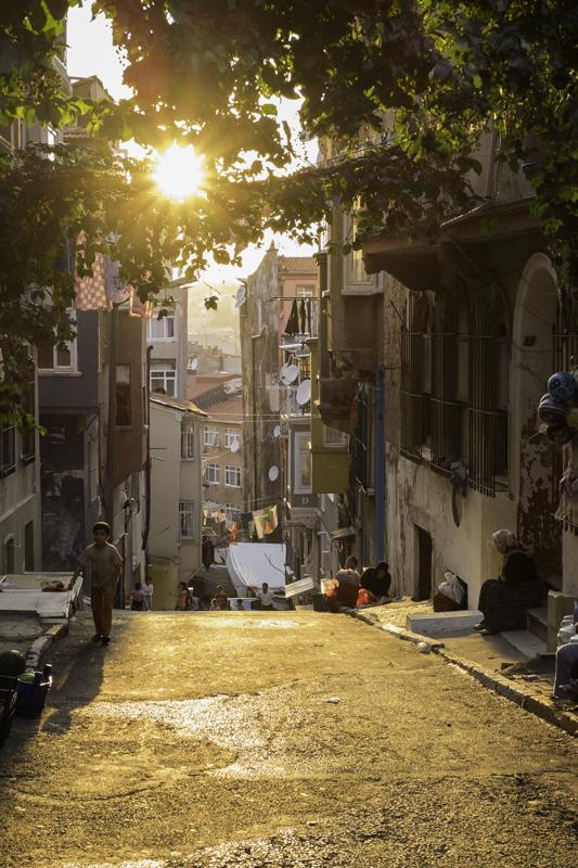 boy-walking-magic-hour-sunset-Tarlabasi-kurdish-istanbul