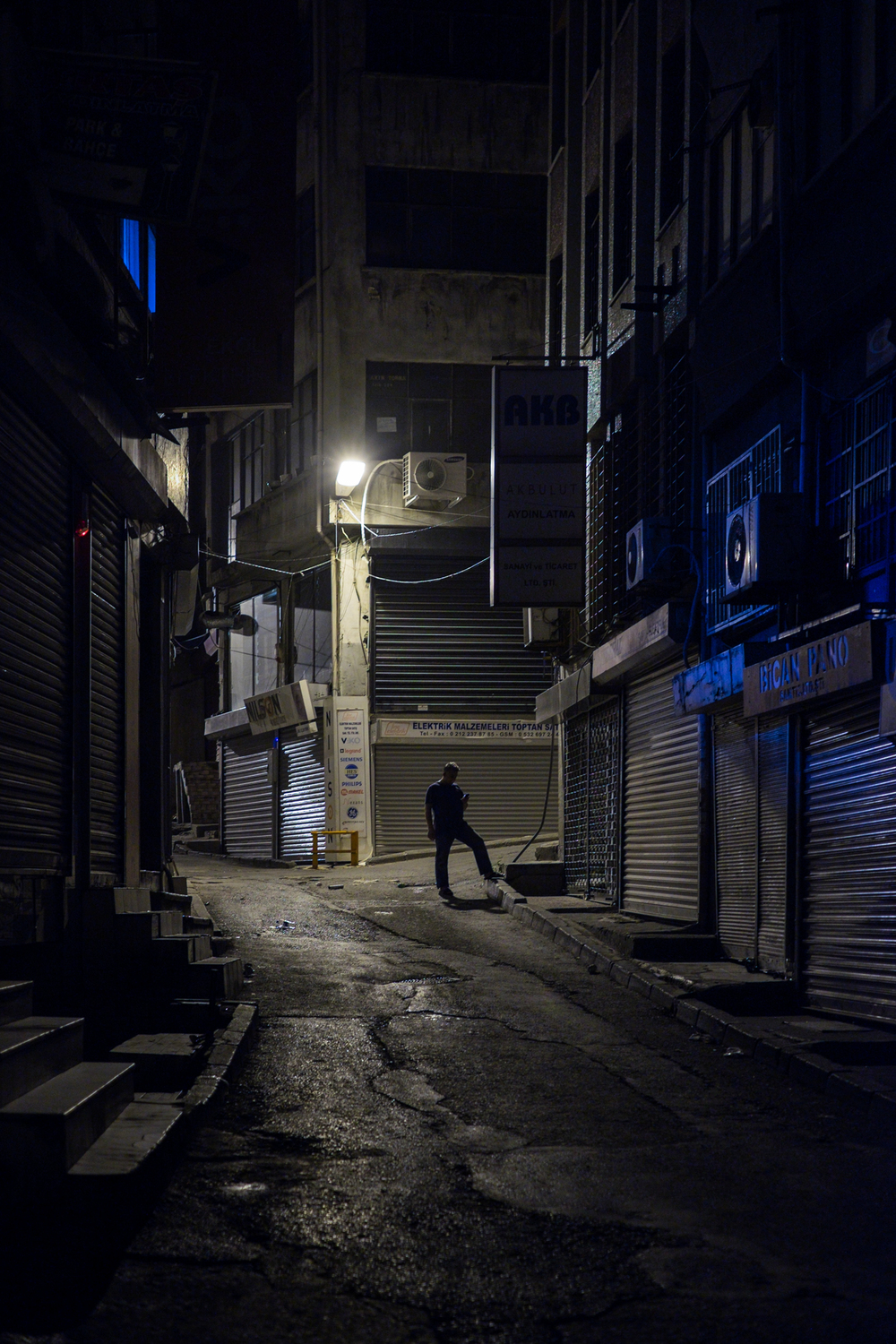 Man-standing-Night-between-Buildings-Shadows-Beyoğlu-Istanbul-Matthew-Coleman-Photography
