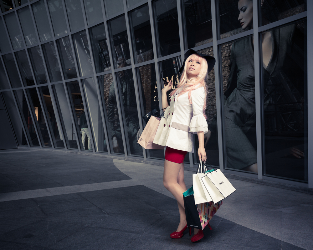Fashion photography with woman shopping, symbolizing consumerism