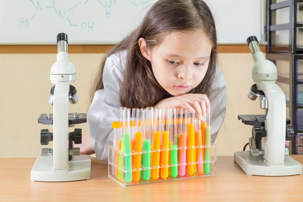Child scientist doing experiment