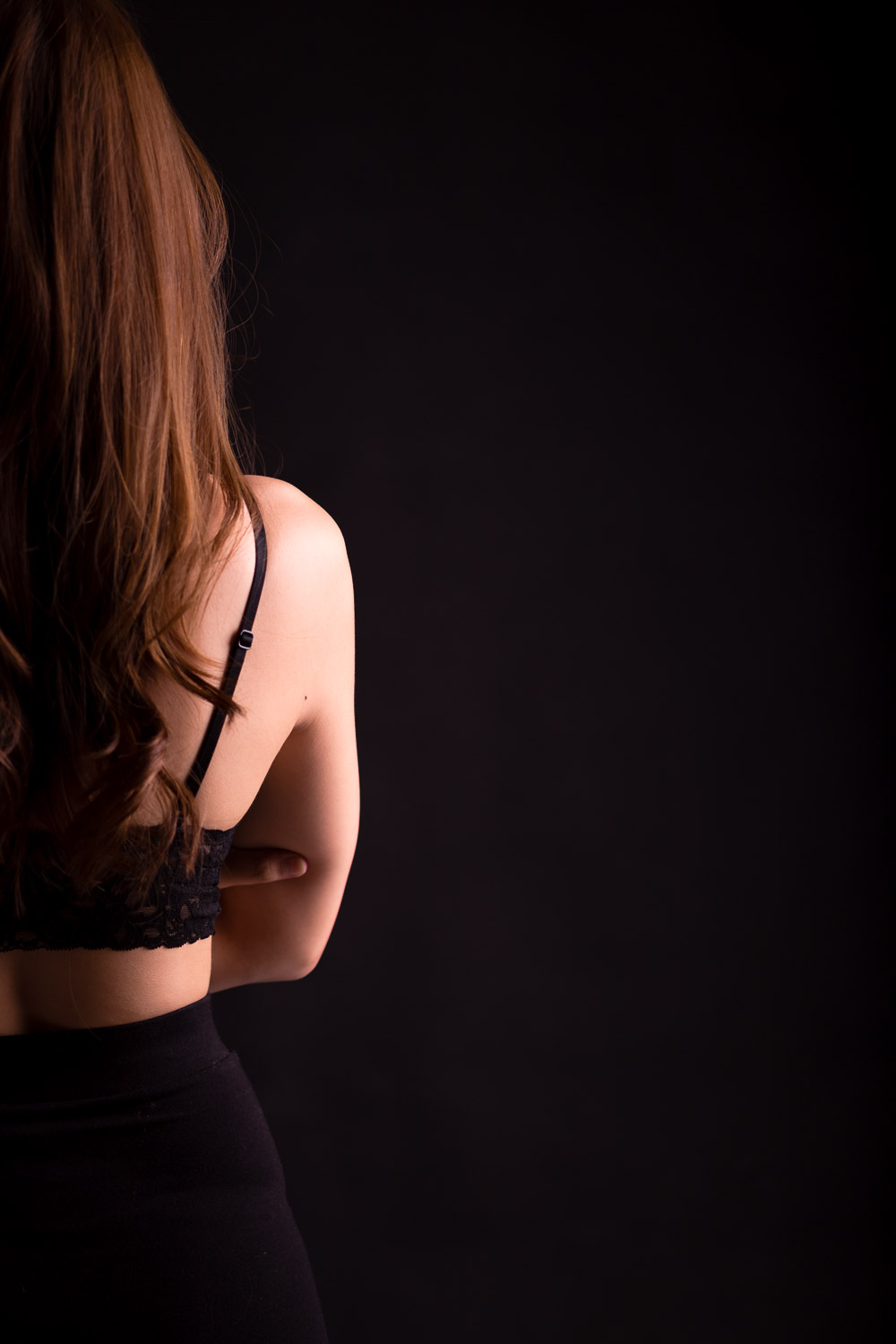 Half of woman from back