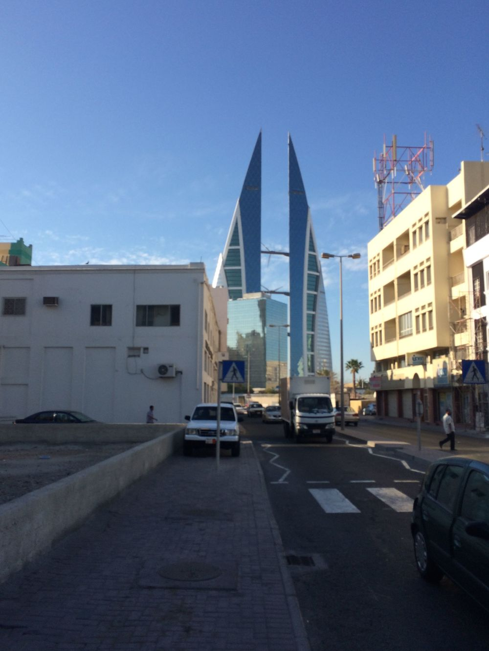 Bahrain World Trade Center, with its wind turbines, just down the block from the neighborhood souq. Also, look! Sidewalks, and they're relatively clean!