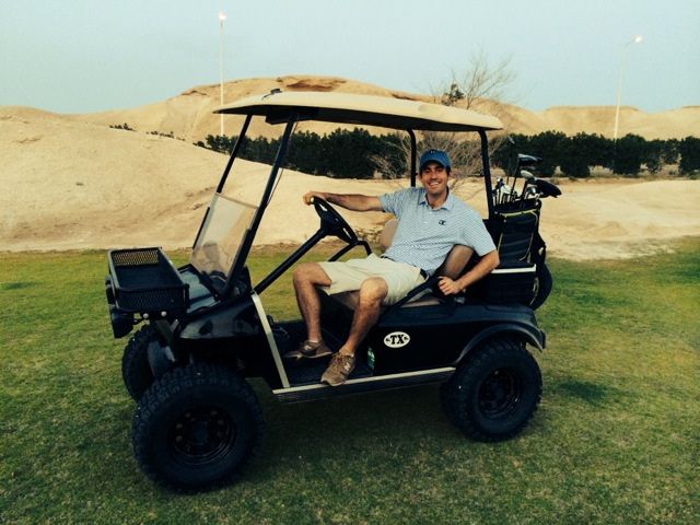 Horovitz chilling on a classic tricked-out Udhailiyah golf cart. Photo by Josh Olson